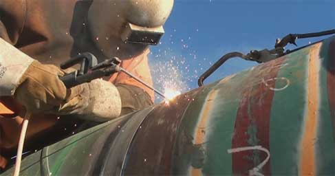 Person welding a pipeline